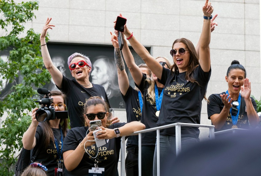 Members of the U.S. women's soccer team, including Megan Rapinoe, rear left, and Alex Morgan, right foreground, stand on a float before being honored with a ticker tape parade along the Canyon of Heroes in New York, Wednesday, July 10, 2019. The U.S. national team beat the Netherlands 2-0 to capture a record fourth Women's World Cup title. (AP Photo/Craig Ruttle)